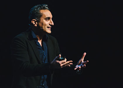 Bassem Youssef addresses a crowd from the stage