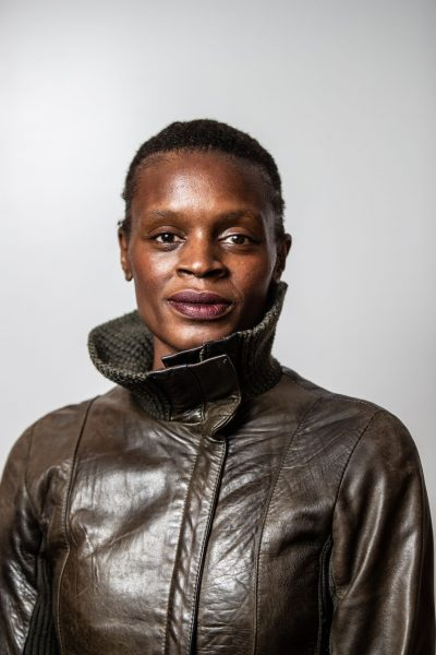 Artist in residence Okwui Okpokwasili poses for a headshot in a leather jacket.