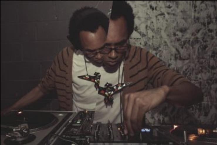 DJ Jace Clayton adjusts a sound board.
