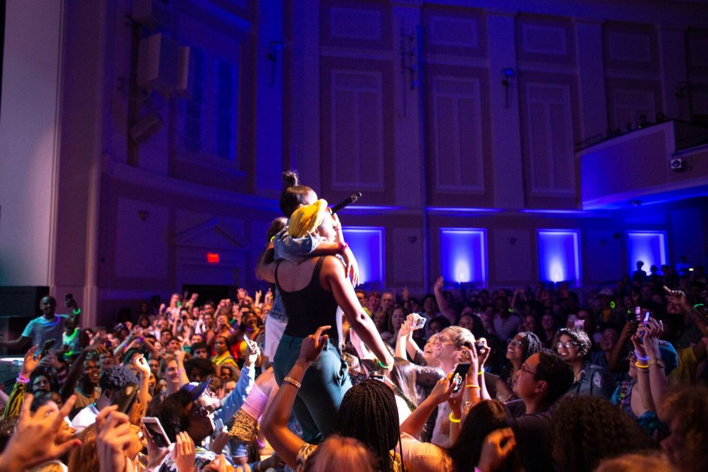 A sold-out crowd of students joins rapper Tierra Whack in the pit at her concert.