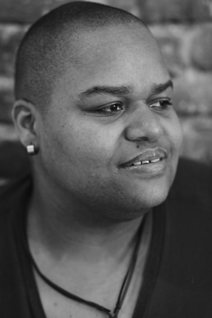 Toshi Reagon looks off into the distance for a headshot.
