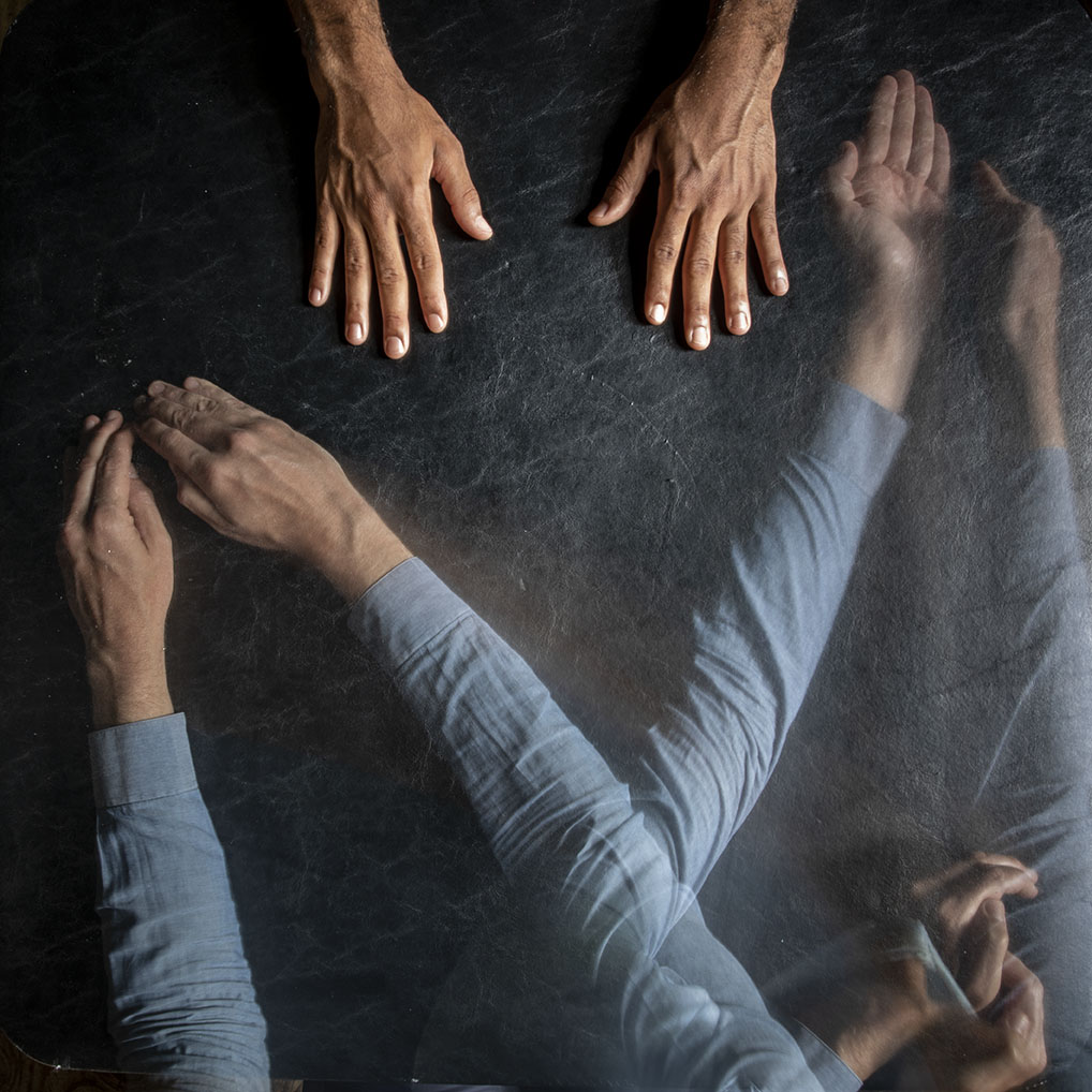 blurry hands on a dark background