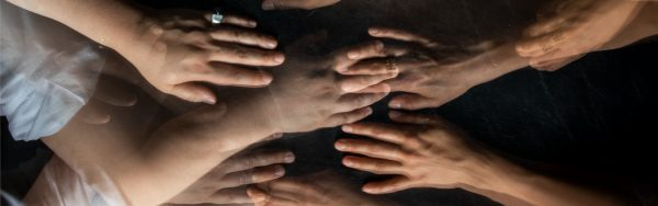 several hands reaching out for each other