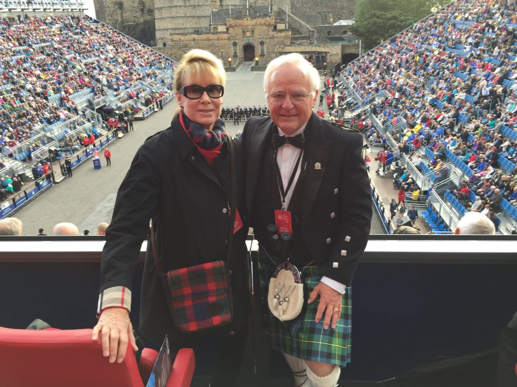 Donors Carol and Rick McNeel pose for a picture wearing traditional Scottish attire.