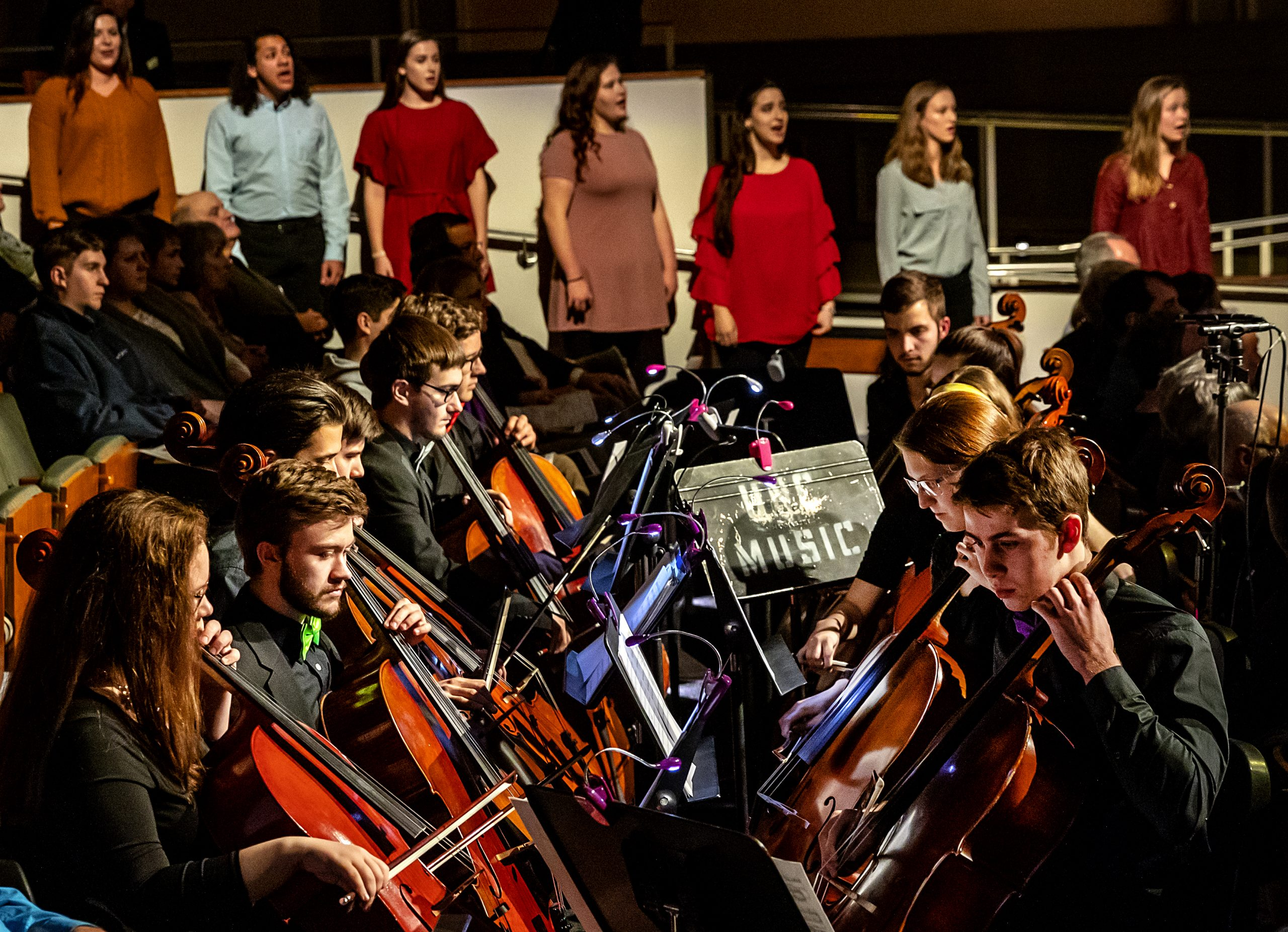 A group of students plays their cellos in UNC Music's Spectrum concert at Moeser Auditorium.